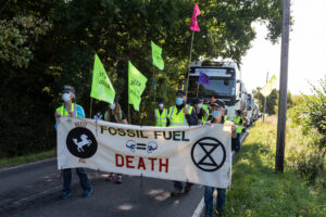 protesters with banner in front of lorry on Horse Hill